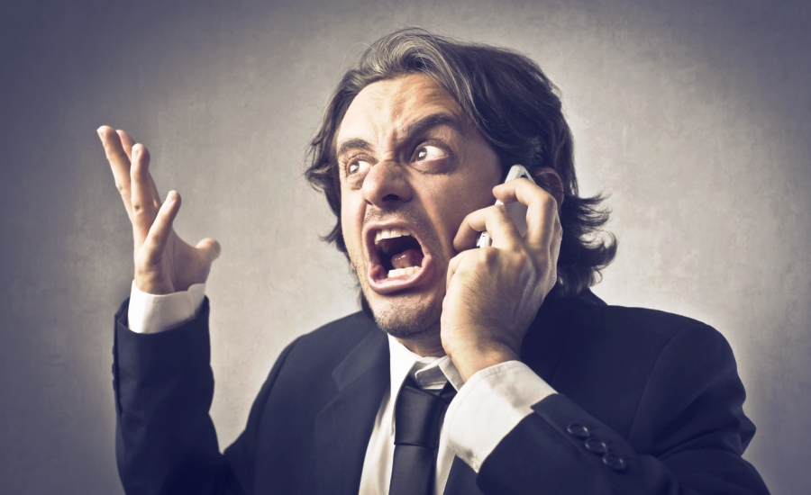 Angry businessman on mobile phone